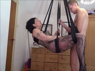 Stepson hangs stepmother in the sex swing