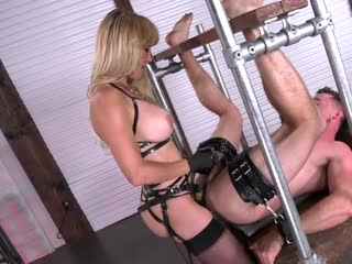 Beautiful mistress fucks slave in the ass with a strap-on dildo