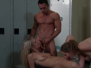 Two young girls fuck a hunk in the dressing room